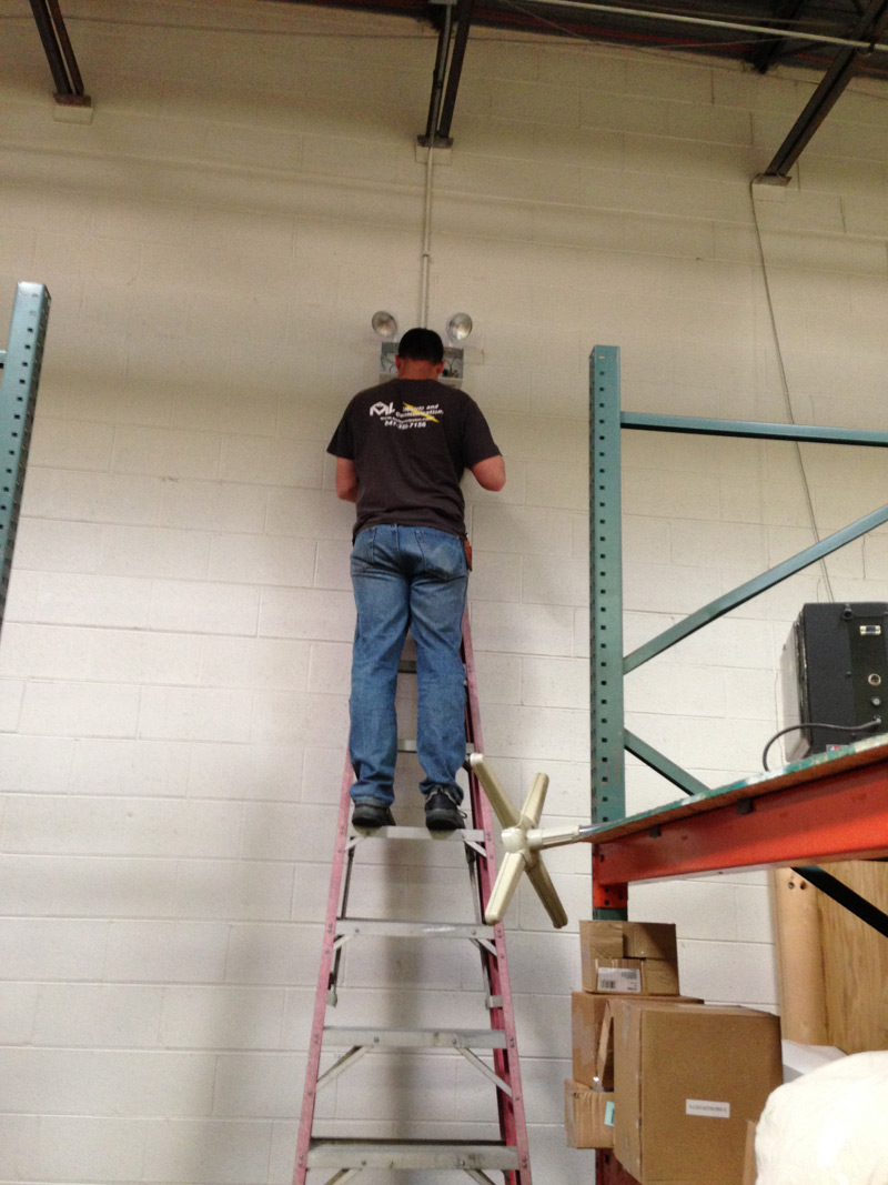 Electrician installing Chicago approved emergency light